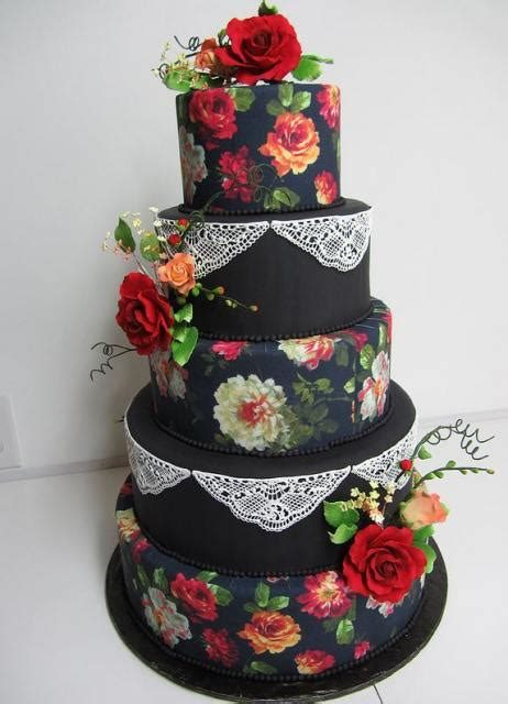 Five tier black round wedding cake with red roses